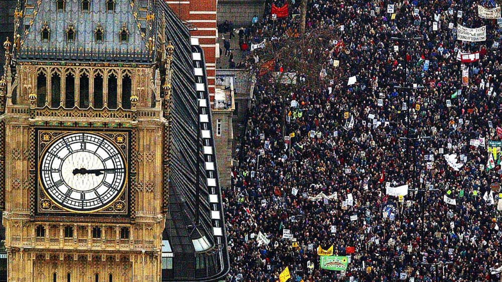 Anti-war protestors march past Big Ben during a demonstration against war on Iraq, February 15, 2003..